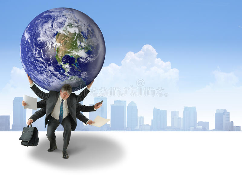 Busy Man Weight of World on Shoulders Difficulty. Busy business man with many arms full and the wight of the world on his shoulders with a cityscape background stock images