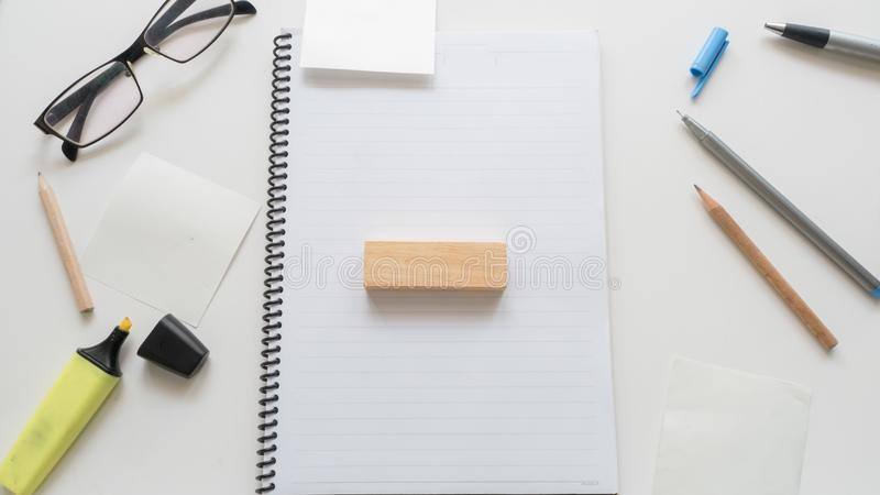 busy business Office desk table and wooden block work word written on wood block on white background royalty free stock image