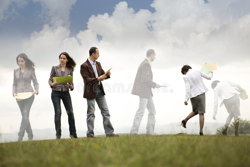 Busy business people on the move royalty free stock photo
