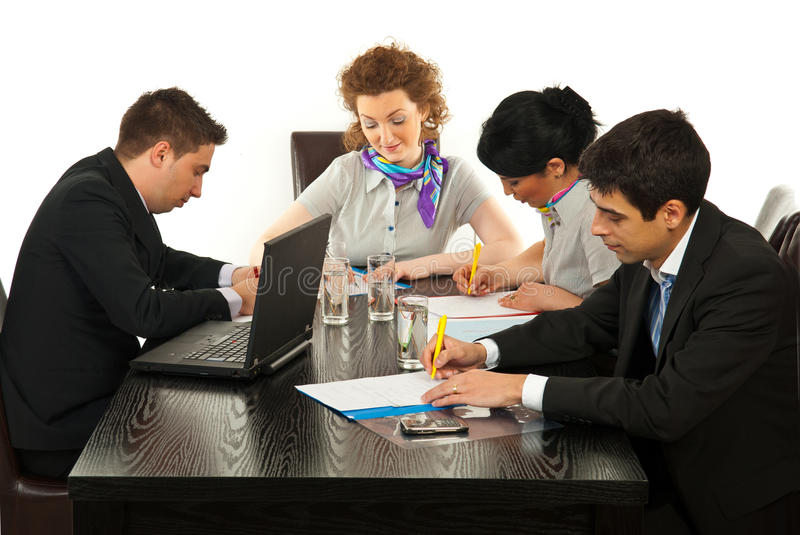 Busy business people in office stock photography