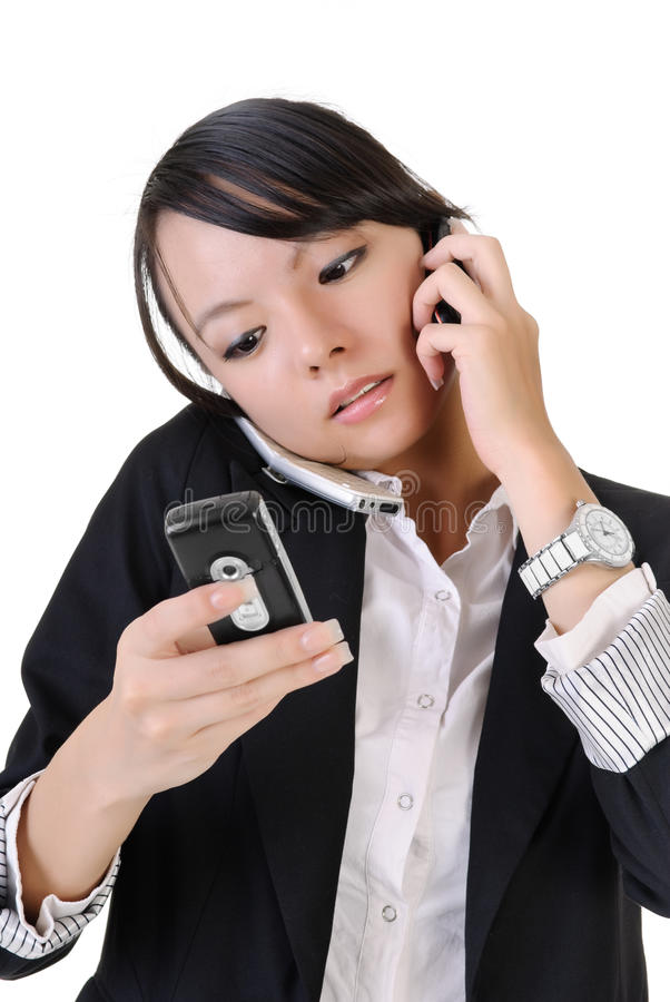 Busy business woman. Using cellphone and reading SMS, closeup portrait on white background royalty free stock image