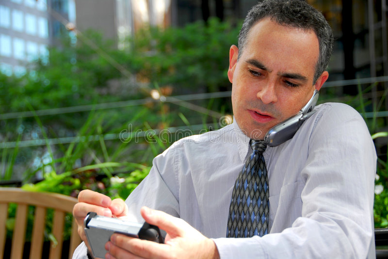 Download Busy businessman stock photo. Image of executive, multitask - 1336410