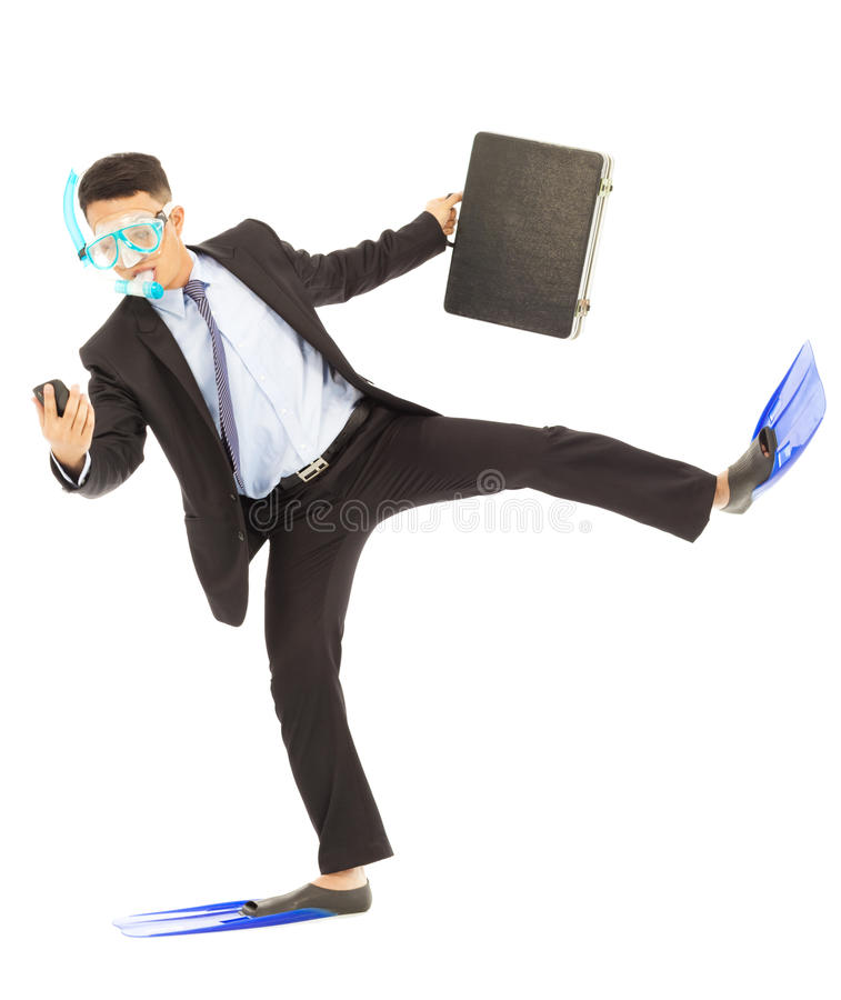 Busy businessman put on scuba gear to work stock photo