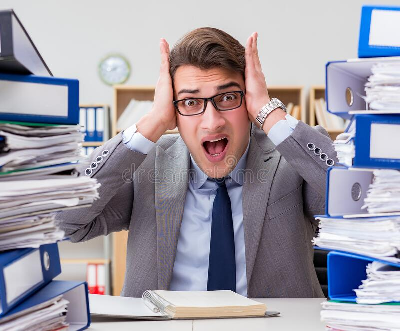 Busy businessman under stress due to excessive work royalty free stock photos