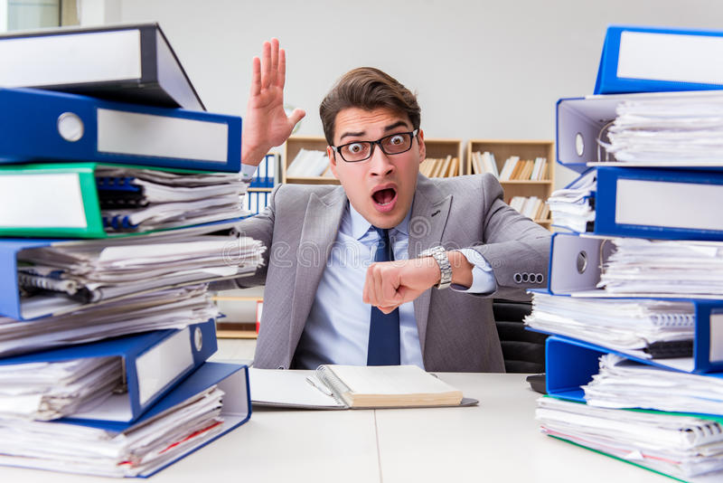 The busy businessman under stress due to excessive work royalty free stock photo