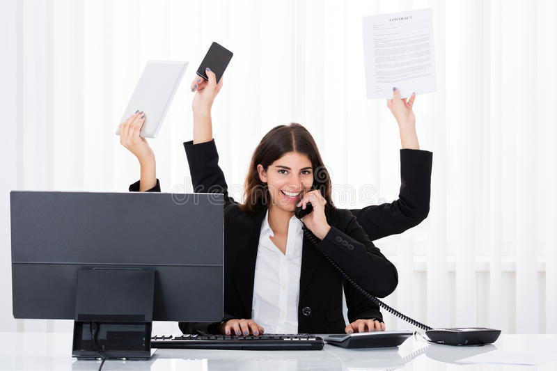 Busy Businesswoman Multitasking royalty free stock photos