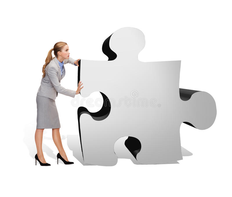 Busy businesswoman pushing puzzle piece royalty free stock photos
