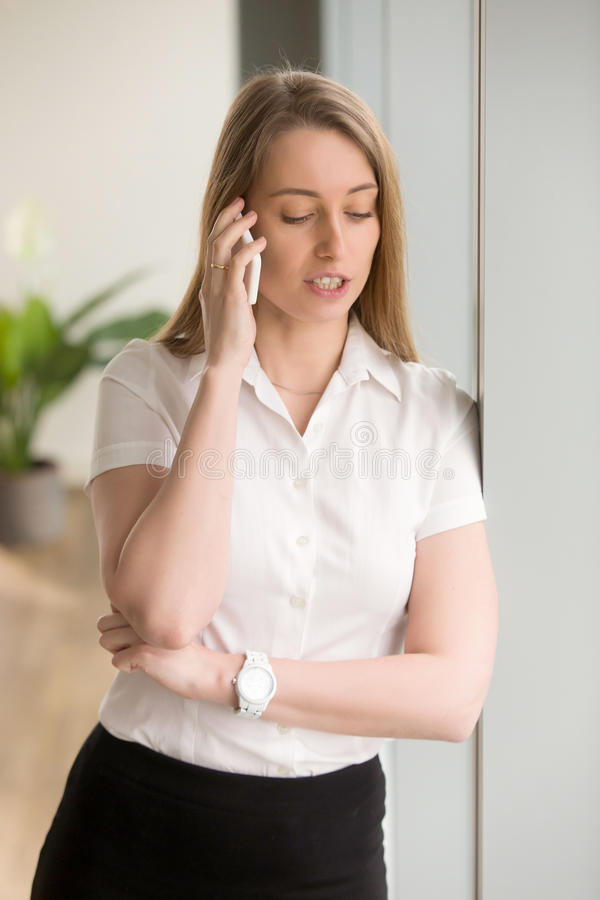 Busy businesswoman talking on cellphone royalty free stock image