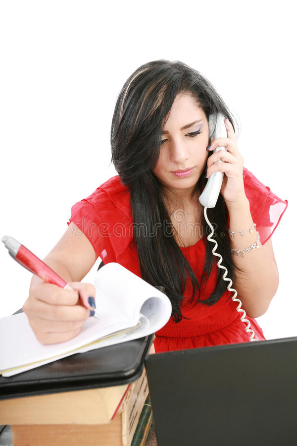 Busy businesswoman using mobile phone stock image