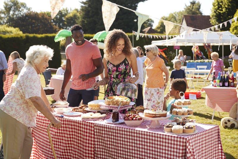 Busy Cake Stall At Summer Garden Fete stock photos