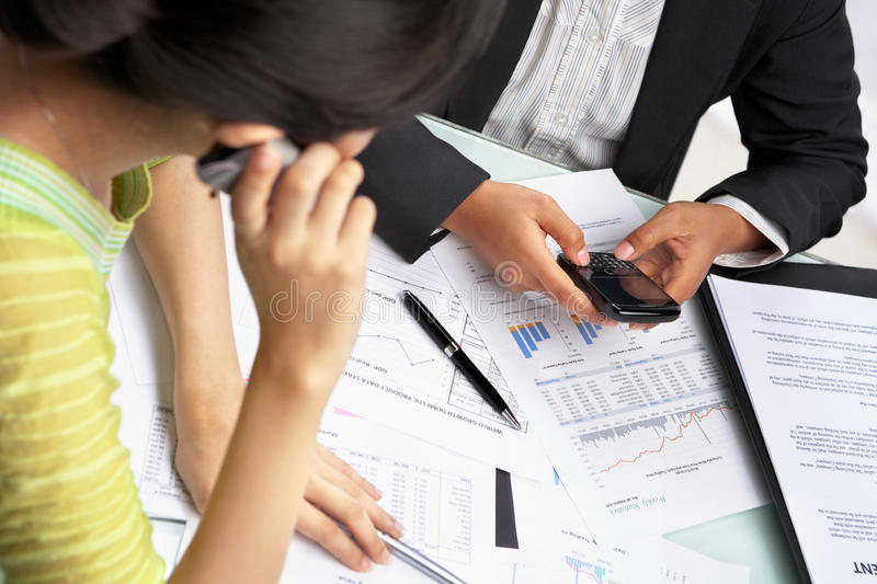 Busy on cell phone while working stock photos