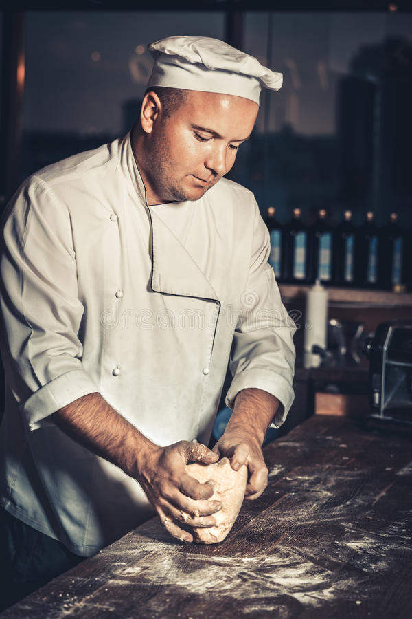 Busy chef at work in the restaurant kitchen stock photography