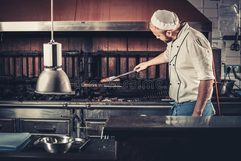 busy restaurant kitchen. Download Busy Chef At Work In The Restaurant Kitchen Stock Image - Of Oven,