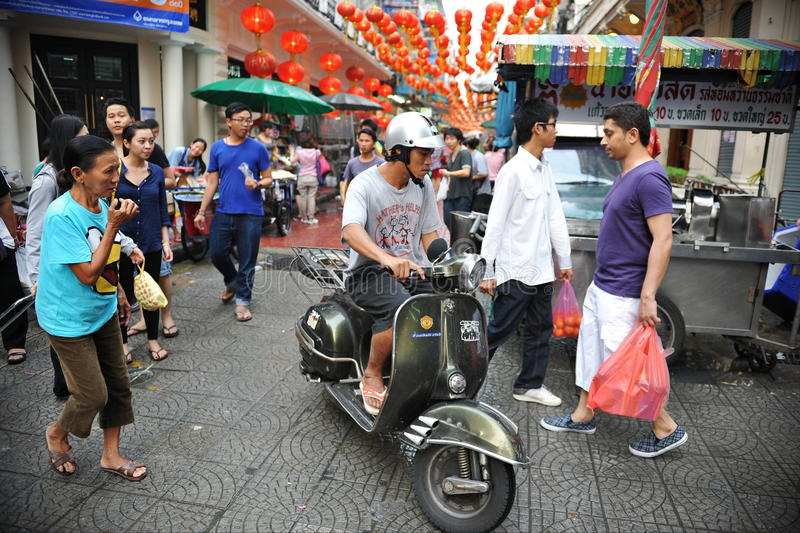 Busy Chinatown Street. People make their way along a busy market street in Chinatown on February 4, 2012 in Bangkok, Thailand. Chinese began settling in the Thai royalty free stock photo