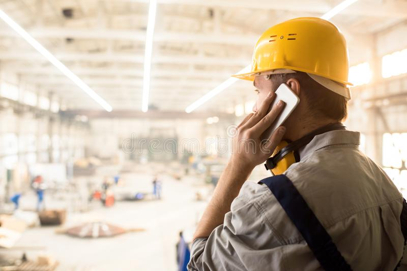 Busy construction manager calling customer stock photos