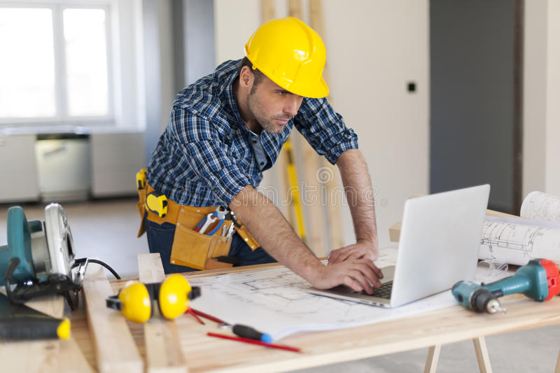 Busy construction worker royalty free stock photography