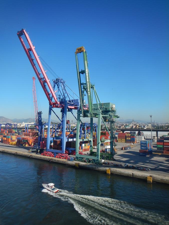Busy container terminal with two cargo cranes waiting for operation stock photo