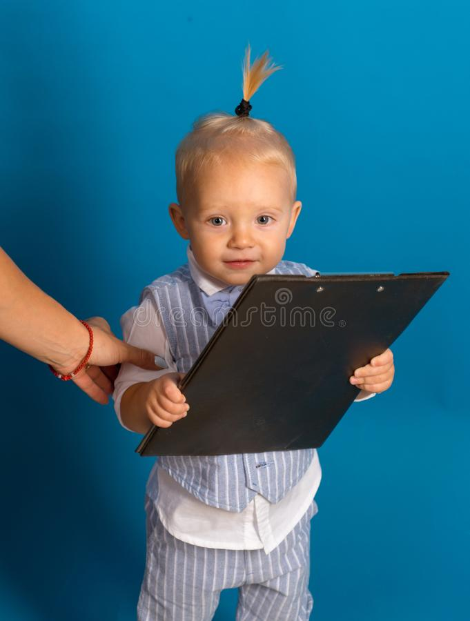 Busy cutie. Small child. Small baby boss. Adorable child manage business. Boy child plan startup business strategy stock image