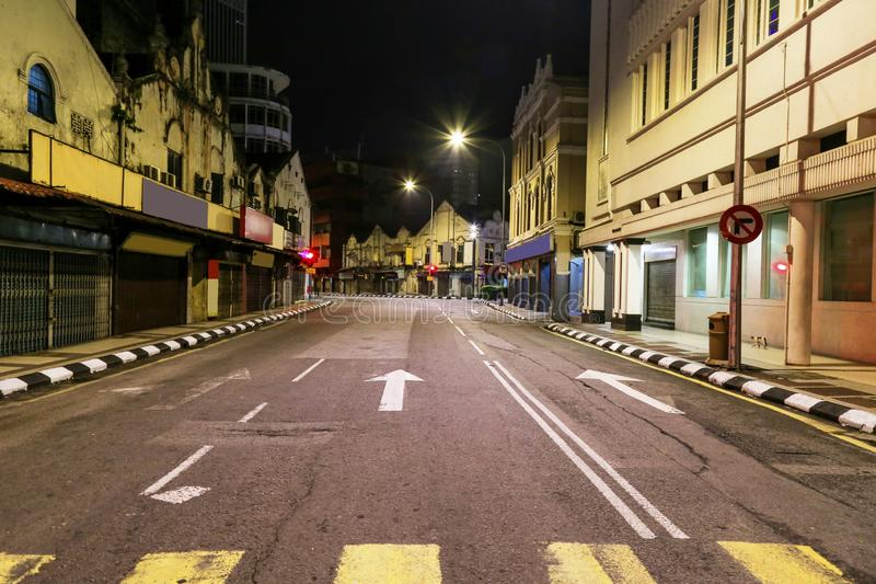 Busy during day but no traffic late at night on this road in Kuala Lumpur Malaysia. royalty free stock images