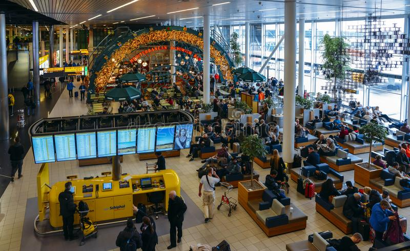Busy departure lounge at Amsterdam`s Schiphol Airport. Amsterdam Schiphol, Netherlands - Jan 13, 2018: Busy departure lounge at Amsterdam`s Schiphol Airport stock photography