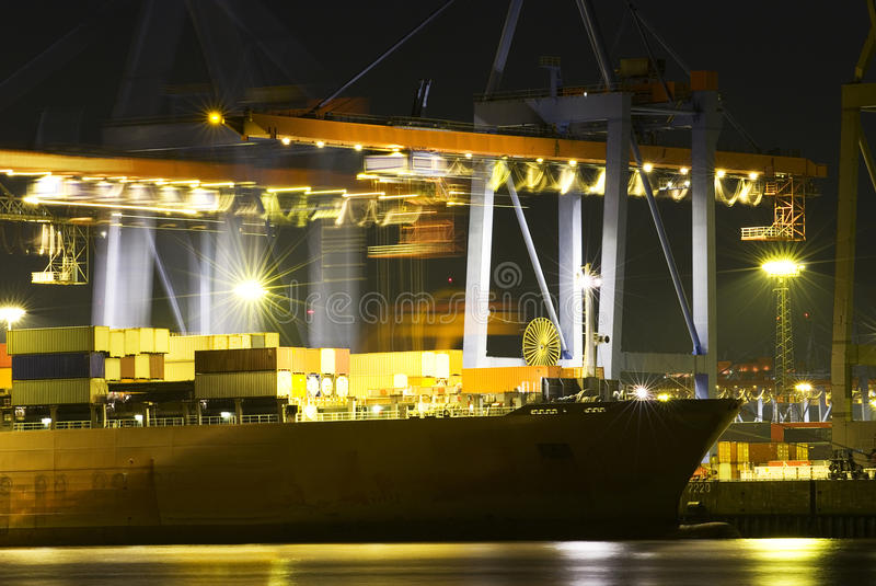 Busy dock at night stock photo