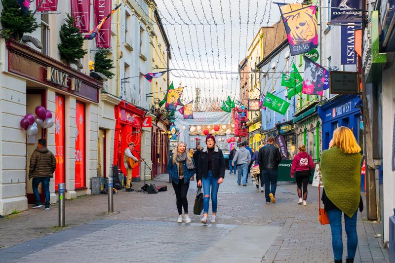 The busy downtown in Galway, Ireland, on a cloudy autumn evening. GALWAY, IRELAND - NOVEMBER 6, 2019: The busy downtown in Galway, Ireland, on a cloudy autumn stock image