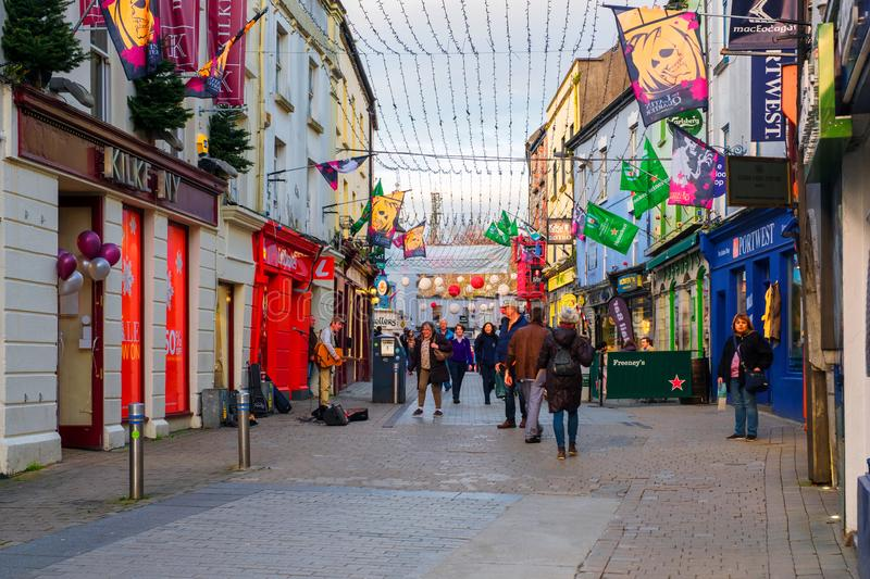 The busy downtown in Galway, Ireland, on a cloudy autumn evening. GALWAY, IRELAND - NOVEMBER 6, 2019: The busy downtown in Galway, Ireland, on a cloudy autumn royalty free stock images