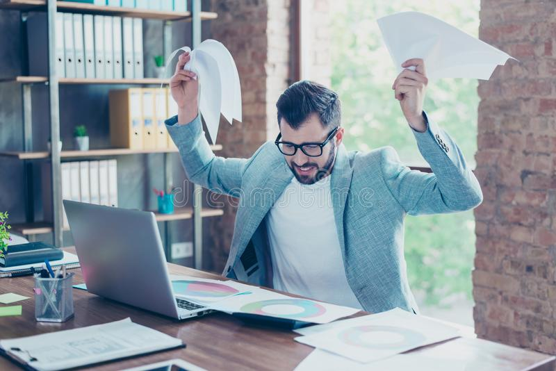 Busy economist under stress due to excessive work, having a lot stock images