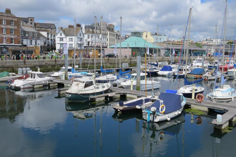 A busy harbour at Plymouth Devon England stock images