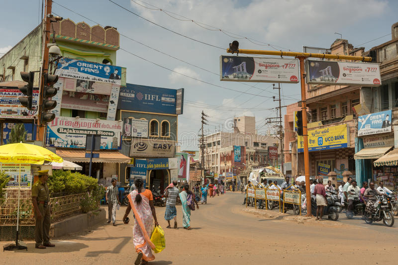Busy intersection in Karaikudi city. Chettinad, India - October 17, 2013: Busy intersection in Karaikudi city shows one police agent. Traffic is dense. People stock photography