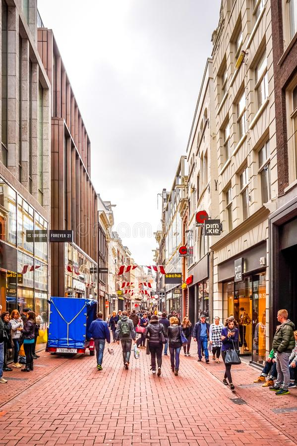 The busy Kalverstraat, a famous and touristic shopping street in the center of the old city of Amsterdam stock images