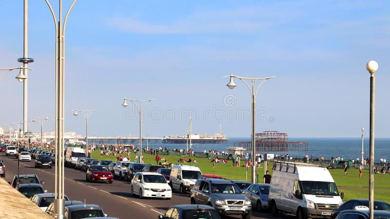 Busy Kings Road at Hove Lawns Brighton. A view of the busy Kings Road, the West Pier and the Palace Pier at Hove Lawns, Brighton, Sussex, England royalty free stock photos