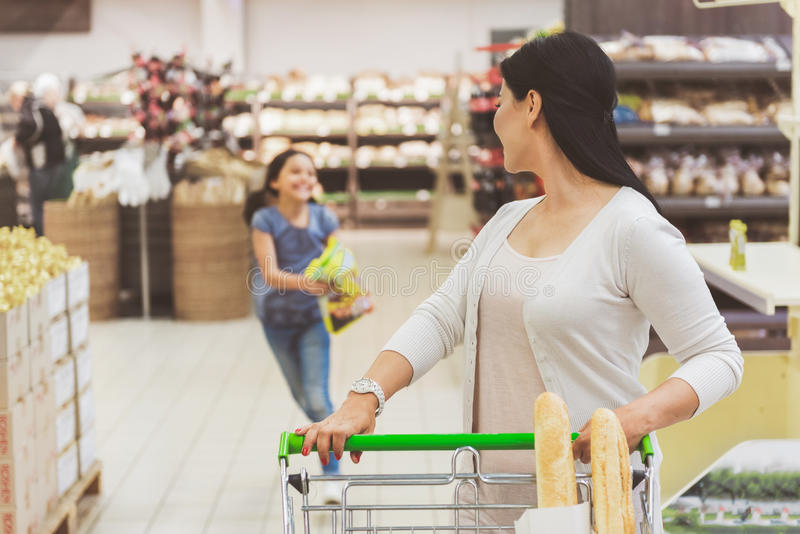 Busy ladies doing funny shopping stock photos