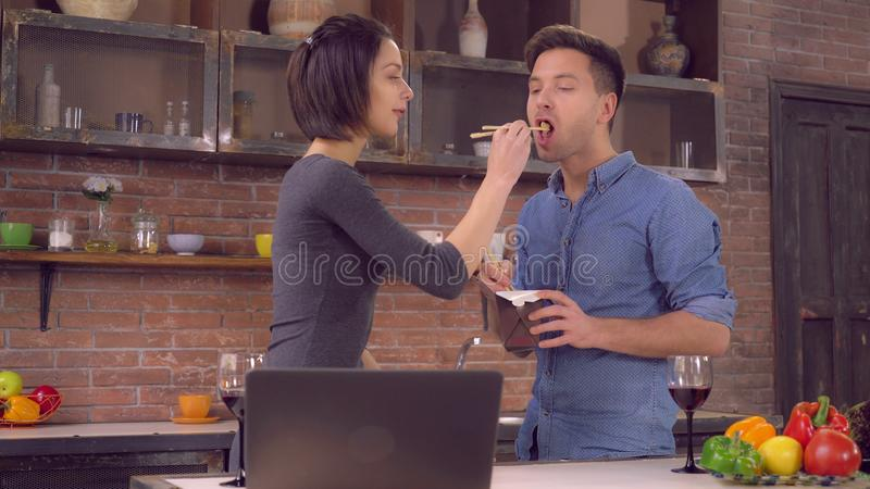 Busy lady and guy eat delivery food stock photo