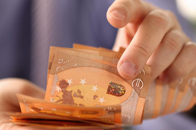 Busy Man Counting Euro Savings Finance Concept stock photography