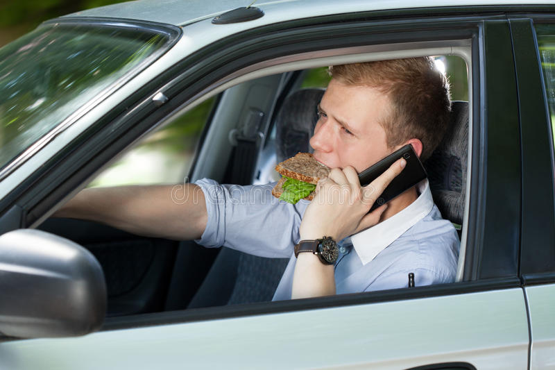 Busy man driving a car royalty free stock images