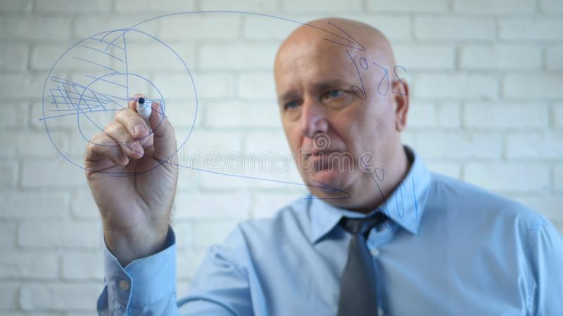 Busy Manager Draw a Business Plan on Board in Meeting Room stock photo