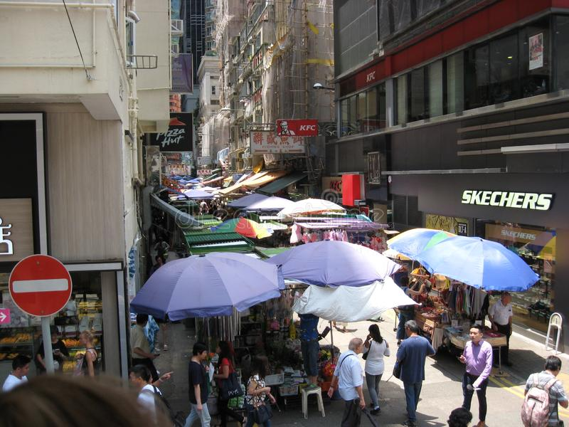 A busy narrow pedestrian street on the main island, Hong Kong stock photo