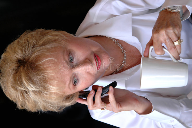 Busy mature business woman stock photography