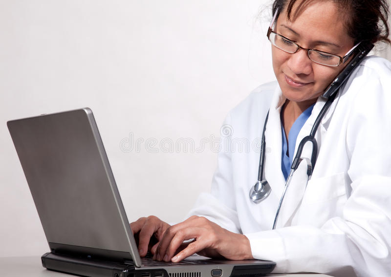 Busy medical secretary. Attractive thirties asian medical woman doctor royalty free stock photos