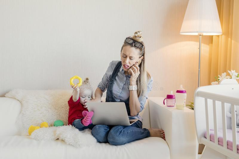 Busy mom doesn`t have time for her kid royalty free stock photo