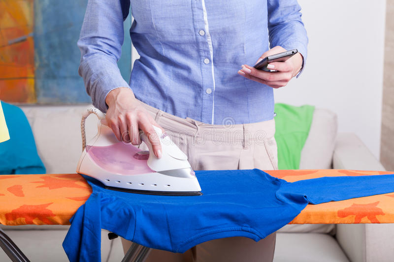 Download Busy mum during ironing stock photo. Image of businesswoman - 43683514