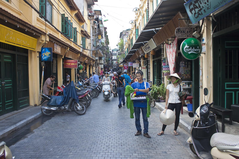 Busy narrow alley. HANOI - AUGUST 9: Busy narrow alley on August 9, 2012 in Hanoi, Vietnam. Hanoi has an estimated population of 6.5 million making it the second stock photos