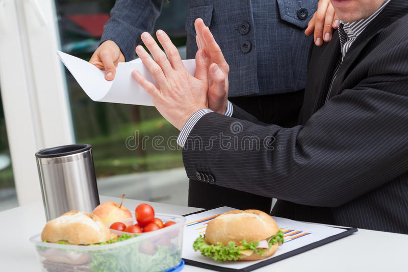 Busy nervous businessman in work stock photography