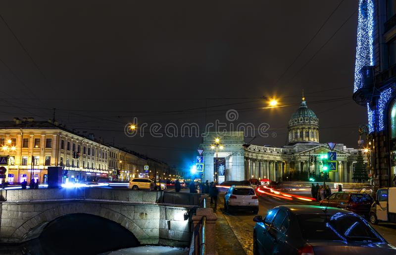 Busy Nevsky Prospect with old houses and Kazan Cathedral, Night St. Petersburg, Russia. Busy Nevsky Prospect. Old houses and Kazan Cathedral. Night St stock photography