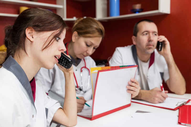 Busy nurse staff is phoning stock photos