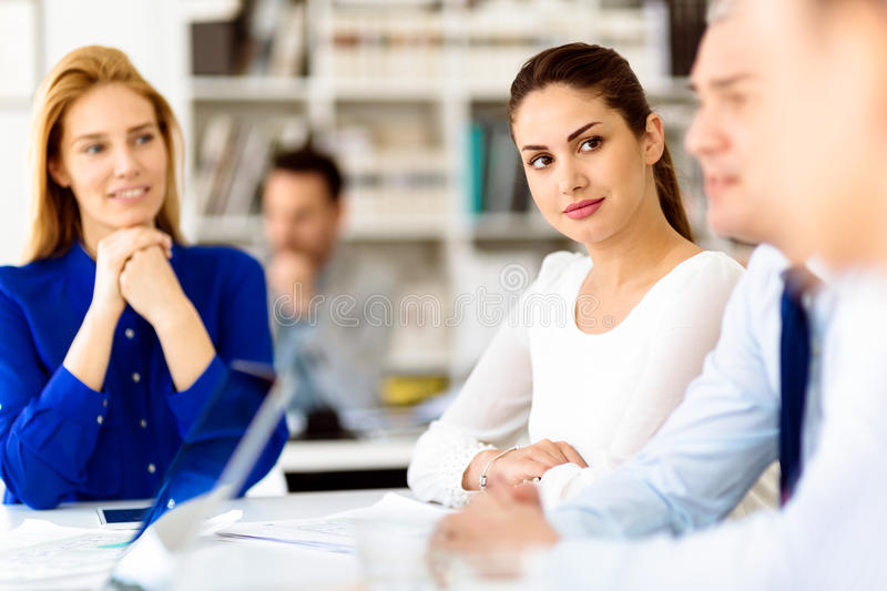 Busy office life. Busy business people working in office stock image