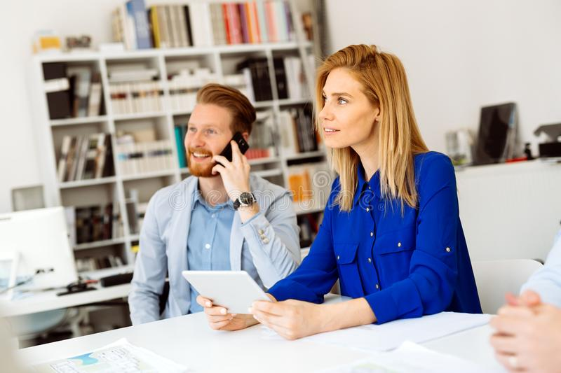 Busy office life. Busy young business people working in office royalty free stock photo