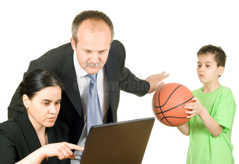 Busy parents. Too busy parents who don't have time to play with their son stock photography