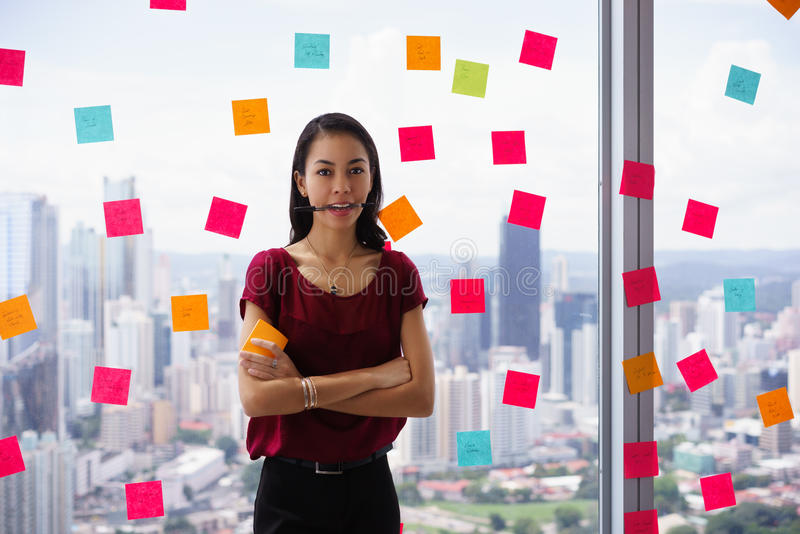 Busy Person Holds Sticky Note On Mouth With Emoticon royalty free stock photography